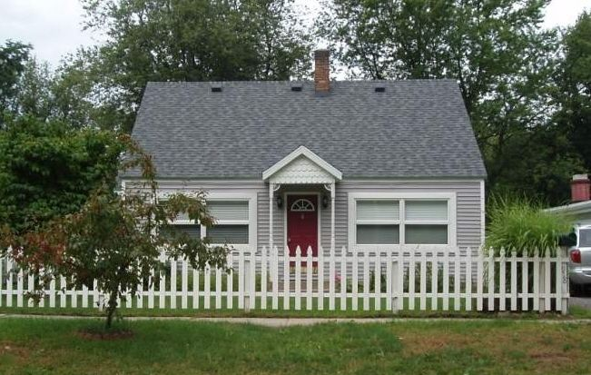 The Cottage With White Picket Fence