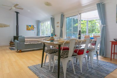 Spacious living and dining open out to tree top deck