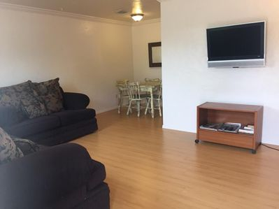 The living room features internet and cable access.
