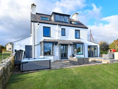 Photo for Beautifully presented in a rich modern style and perfectly spacious for large families, this delight