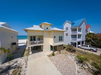 Photo for Fall Specials! Tropical Daze has no hurricane damage! Pet Friendly!  Summer booking fast! Stunning family friendly beach front home with gorgeous views, nearby bay access, and large balcony!