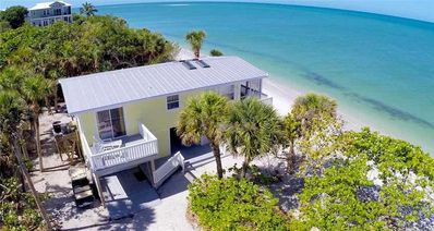 Photo for AMAZING 3 BEDROOM 3 BATH BEACH FRONT COTTAGE 50 FEET TO THE GULF OF MEXICO!