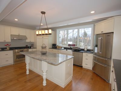 Photo for 5 Bedroom Ski on Ski off, Perfect location on the Sachem Trail. Hot Tub