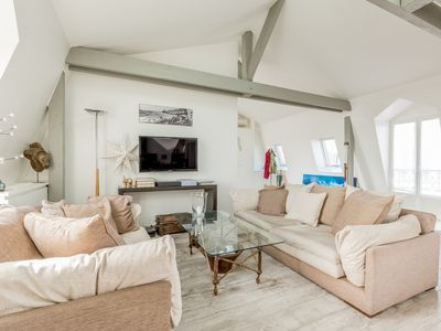 Photo for Amazing rooftop apartment with terrace and a fantastic view of Pantheon & Paris