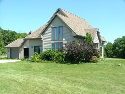 Beautiful country home on five scenic acres.