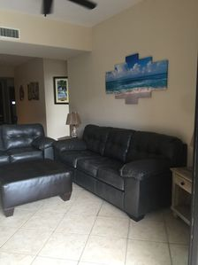 Queen size sofa sleeper in living room with memory foam mattress
