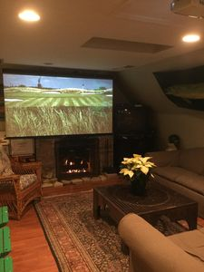 Living space with fireplace and projection TV