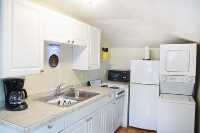 bright and clean kitchen with washer and dryer