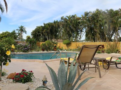 Photo for Stunning Tropical Oasis ~ 3 miles, 6 minutes to WEF ~ 32' Heated Salt Water Pool