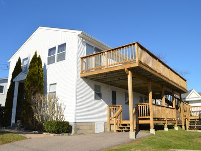 Photo for Quick Walk to the Beach! Amazing Water Views! Spacious Deck!