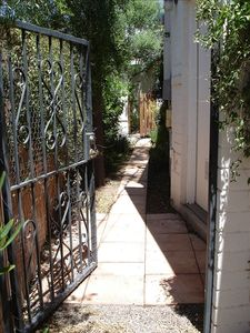 Private Entry with wrought-iron gate