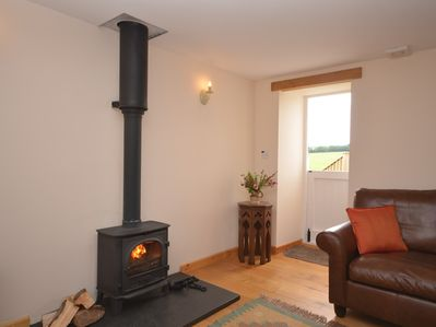 Relax in front of the wood burner during cooler months or open the stable door in the summer