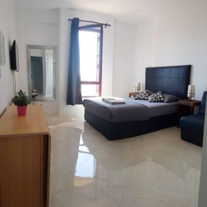 Photo for Modern bright flat + all amenities, close to Oura Beach