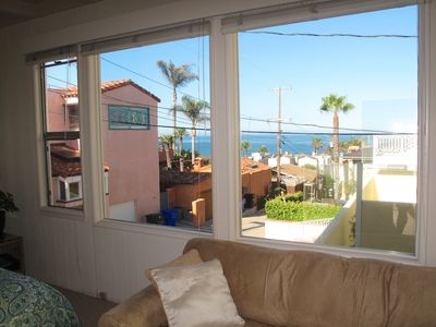 Looking out windows towards ocean from studio apartment.