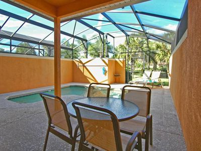 Photo for Free wifi/Private Pool/Communal pool and slides/Tennis courts/4 miles Disney