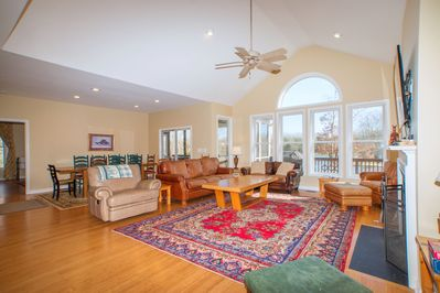 Open living room with waterfront views perfect for family movie nights or games!