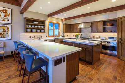 The large kitchen is loaded with top appliances for elegant cooking and catering