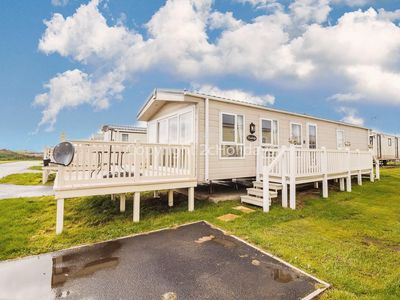 Photo for Caravan near the sea front with decking at St Osyth park Clacton  ref 28005D