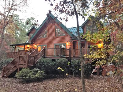 Gorgeous lakefront log home on secluded cove with private beach and boat dock