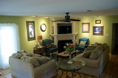 """Living room with oversized couches and 39"""" TV."""
