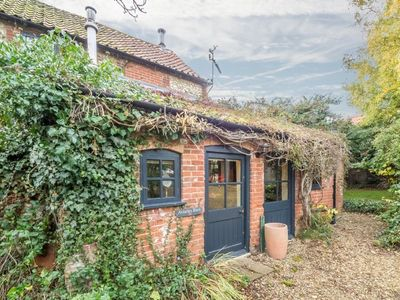 Photo for A stunning barn conversion tucked away in peaceful gardens in Burnham Market.