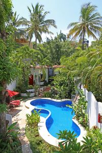 Photo for Hidden Gem! Pool, AC, steps from beach, private, secure & tranquil location