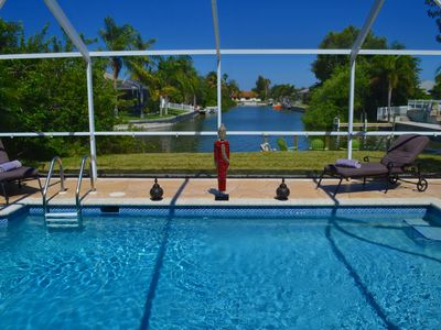Photo for Luxury villa with dock, stunning water view, heated pool, Phone & internet