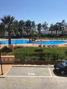 Photo for South facing 1st floor apartment over looking the pools, free wi-fi and sky tv
