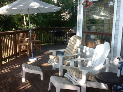 Wrap around deck with comfortable cushioned deck chairs