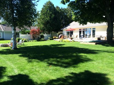 Large landscaped yard on the lake for summer fun  -  lots of flowers