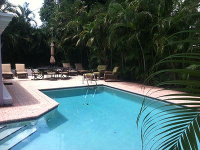 Photo for Tropical Hide-A-Way With Lush Pool Area, Bike To Town & Beach, Pet Friendly