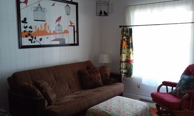Living room with comfy fold-down eight inch full size futon couch.