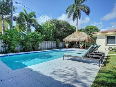 Photo for Walk to Beach & Restaurants!  4BR Solar Heated, Salt Water Pool with Tiki Hut!