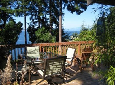 Large deck with seating (table and chairs as well as adirondacks)