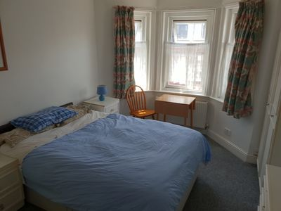 Photo for GF apartment with outdoor area, 10 mins walk from the beach. Sleeps 4