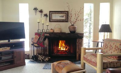 Family room w/ wood burning fire