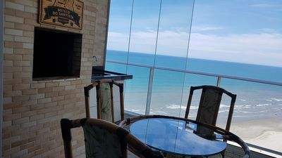Photo for BEAUTIFUL BEACH APARTMENT IN FRONT OF THE SEA WITH PARKING AND WI-FI