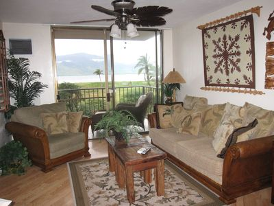 Oceanview living room decorated island style..