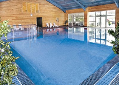 Indoor swimming pool with safe young children's area.