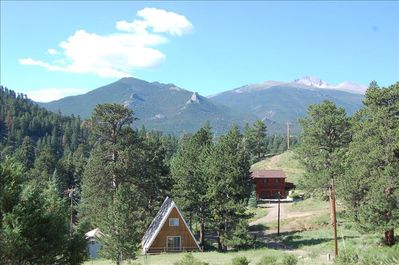 View of rear of the A-Frame with Longs Peak in the distance.