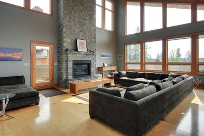 Oversized living area with stunning views and gas fireplace