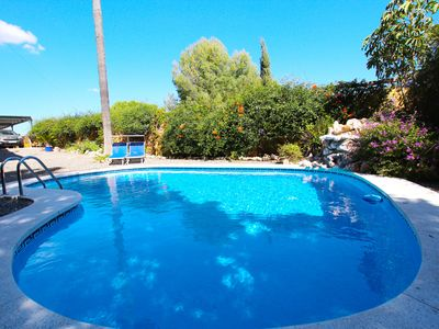 Photo for Sunny villa with beautiful views and pool