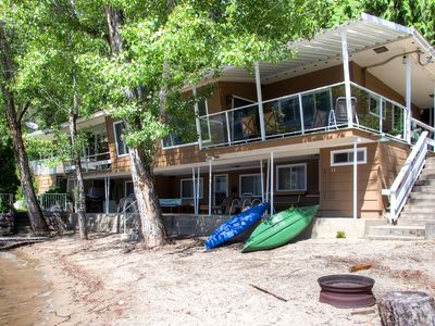 Photo for Absolute lakefront location with lovely sand beach.
