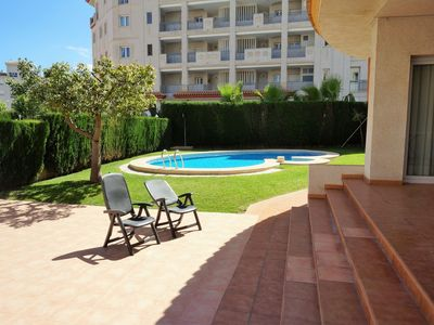 Photo for Light apartment with communal pool and walking distance to the beach