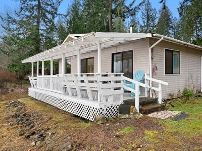 Photo for NEW LISTING! Sunny, waterfront cabin w/ a furnished deck, dock, & firepit!