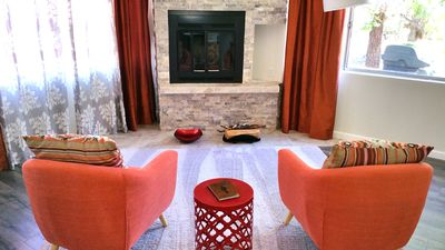 Beautiful stone fireplace with extra plush and comfy rug.