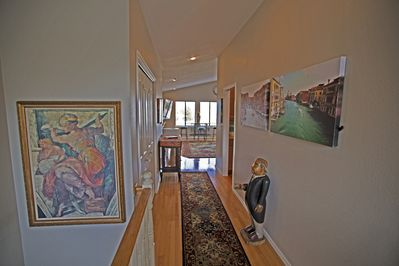ENTRYWAY TO LIVINGROOM, DINING ROOM AND GOURMET KITCHEN