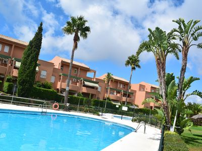 Photo for Ground floor apartment with private garden, pool, Wifi, garage.