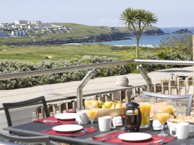 Photo for Stunning views over golf course and Fistral Beach. Accommodation over two floors with private garden