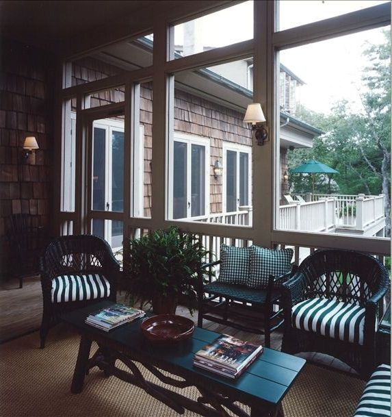 Screened Porch With Outdoor Dining Area Which Seats 10 And Grilling Deck